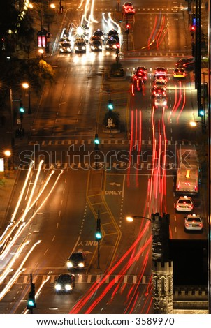 Aerial view of street scenes with traffic at night in downtown Chicago Illinois, USA - stock photo
