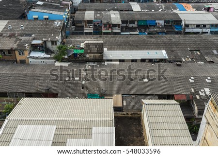Aerial View Of Suburbs Roofs In Thailand City.