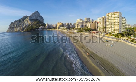 Aerial view of sunny morning on the beach of Calpe, Calp. Penon de Ifach also on the photo.  - stock photo