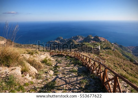 Aerial view of Taormina (Sicily, Italy); Mediterranean sea on background.