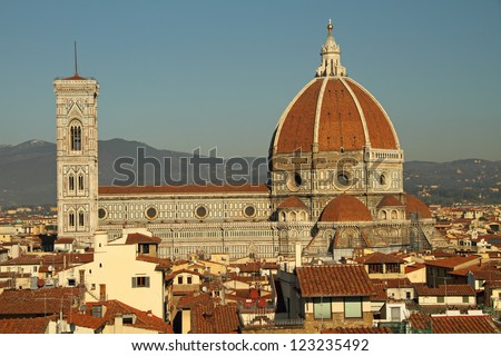 aerial view of The Basilica di Santa Maria del Fiore (  Basilica of Saint Mary of the Flower ) seen from the Arnolfo Tower of Palazzo Vecchio, Florence, Tuscany, Italy, Europe - stock photo