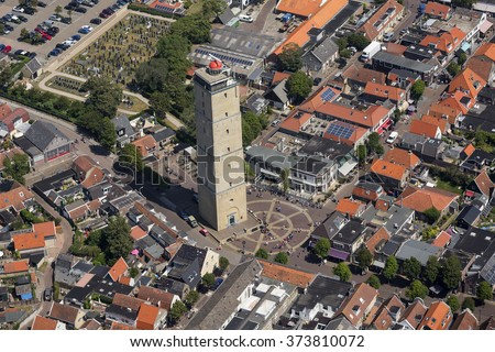 Aerial view of the Brandaris tower at Terschelling, an island in the Waddenzee, Holland. The Waddenzee is on the UNESCO world heritage list. - stock photo