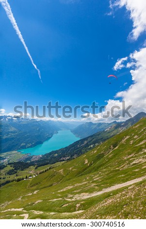 Aerial view of the Brienz lake and the alps from the mountains on hiking trail on Bernese Oberland near the famous tourism region of Interlaken, Jungfrau region, Switzerland. - stock photo