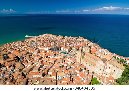 Aerial view of the Cefalu cathedral, Sicily island in Italy. Lovely sea and mediterranean historical houses. Province of Palermo. - stock photo