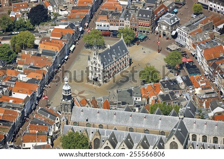 Aerial view of the city of Gouda with the old Town-hall, Weigh-house and St. John church in the province of Zuid-Holland, the Netherlands.
