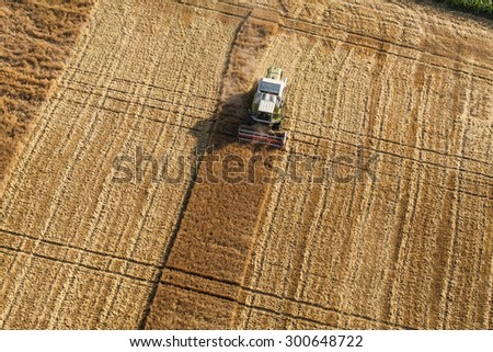 aerial view of the combine on harvest field in Poland.