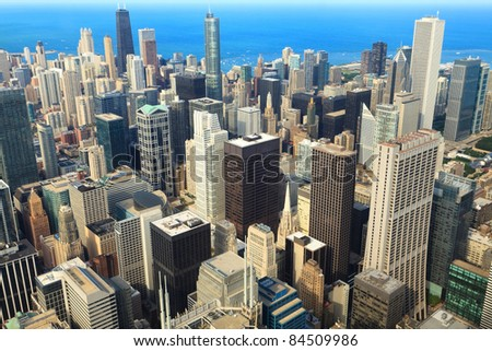 Aerial view of the core of downtown Chicago with Lake Michigan in the background. - stock photo