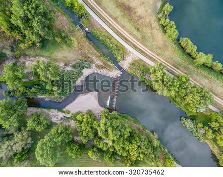 aerial view of the diversion dam providing water for farming - Cache la Poudre River near WIndsor, Colorado - stock photo