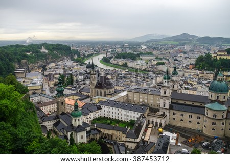 Aerial view of the historic city of Salzburg at fog and cloudy weather, Salzburgerland, Austria - stock photo