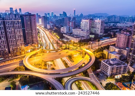 aerial view of the huangpu interchange at guangzhou in nightfall - stock photo