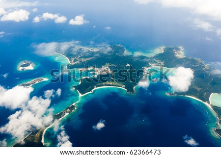 Aerial view of the Japanese tropical islands surrounded by coral reefs with clear blue water, Kerama Islands, Okinawa, Japan - stock photo