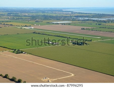aerial view of the Leamington airport with point Pelee in the background; Leamington Ontario Canada - stock photo