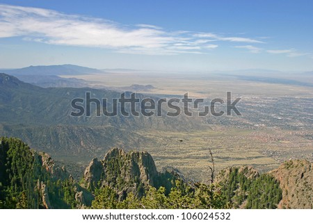 Aerial view of the Manzano and Sandia mountains and part of Albuquerque, New Mexico - stock photo