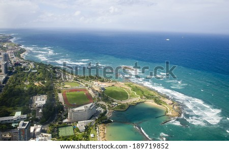 Aerial view of the Northern side of Puerto Rico.  Shown is the North edge shore of the island between Puerta de Tierra and Fuerte de San Geronimo. - stock photo