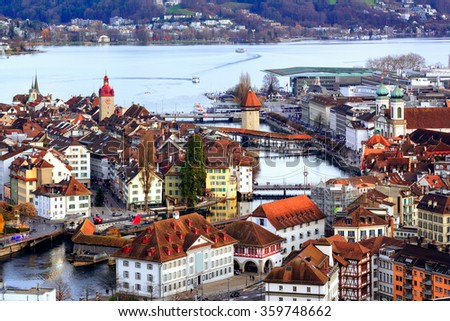 Aerial view of the red tiled roofs of the old town of Lucerne, wooden Chapel bridge, stone Water tower, Reuss river and Lake Lucerne, Switzerland