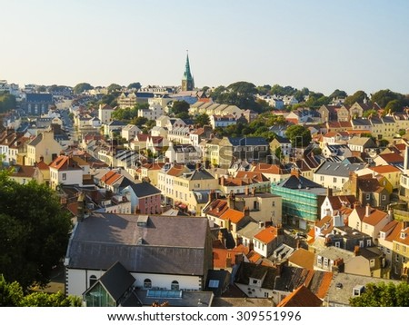 Aerial view of the Saint Peter Port at sunset, Bailiwick of Guernsey, Channel Islands - stock photo