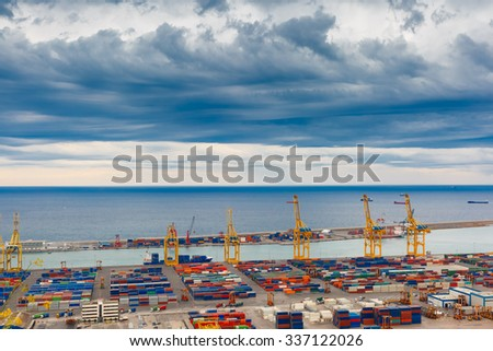 Aerial view of the sea cargo port and container terminal of Barcelona with the Montjuic hill, Barcelona, Catalonia, Spain. - stock photo