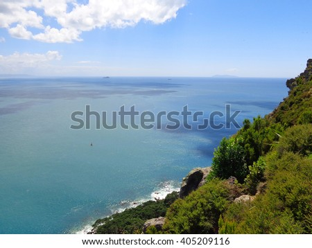 Aerial view of the small ships crossing deep blue sea at sunny day