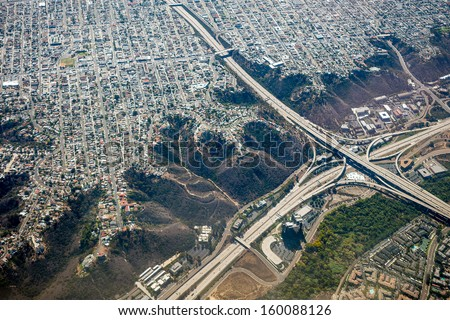 Aerial view of the Suburbs of San Francisco with clouds blanketing the Ocean and Coastline - stock photo