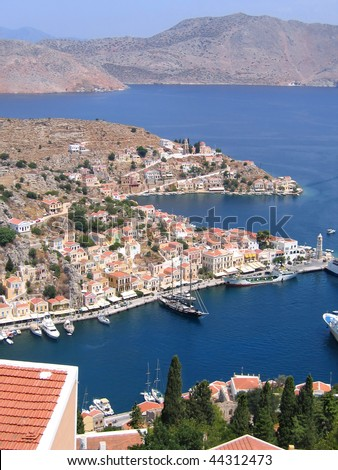 Aerial view of the vessels in the harbor of the Greek city - stock photo