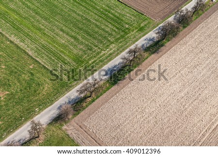 aerial view of the village road and harvest fields  in Poland