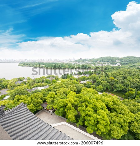 Aerial View of the West Lake and the city of Hangzhou, China - stock photo