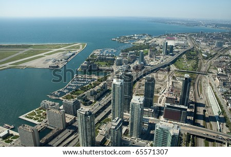 aerial view of Toronto center, airport on left side - stock photo