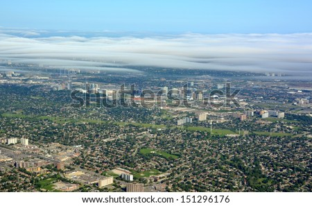 aerial view of Toronto East  and Scarborough near the 401 Highway, nice low cloud cover above Markham, Ontario Canada - stock photo