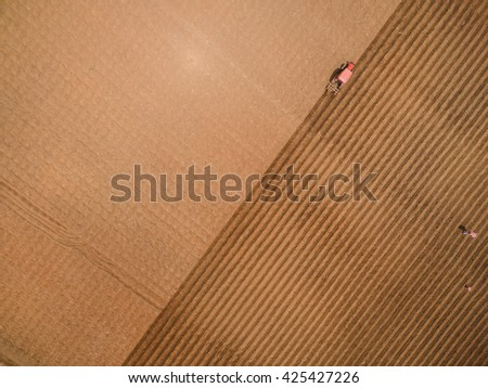 Aerial view of tractor on Prepare a field for planting, top view - stock photo
