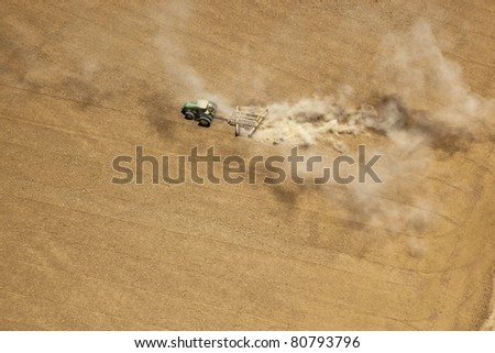 Aerial view of tractor tilling soil