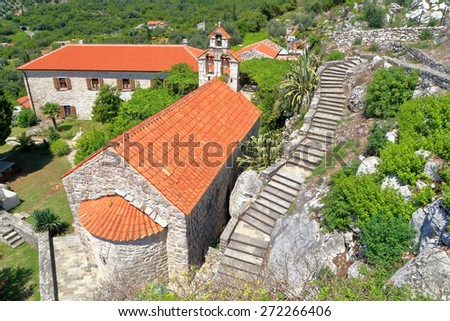 Aerial view of traditional churches of an orthodox monastery near the Adriatic sea, Montenegro - stock photo