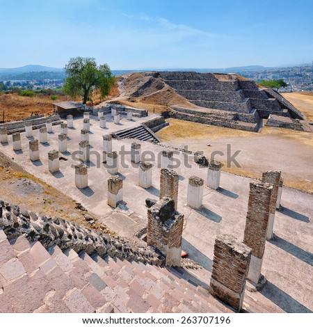 Aerial view of Tula Ruins, Mexico - distorted perspective. Mountain in the background - stock photo