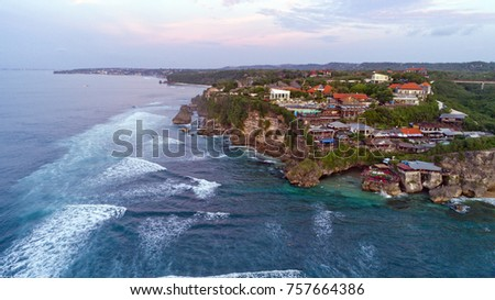 Aerial view of Uluwatu Cliff, famous spot for surfing Bukit Peninsula in Bali, Indonesia