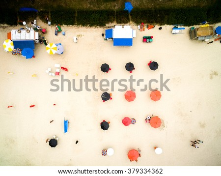Aerial view of umbrellas in beach, Brazil - stock photo