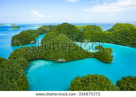 Aerial view of Unesco World Natural Heritage islands of Palau with turquoise blue water, Seventy Islands, Micronesia - stock photo