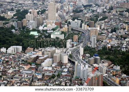 Aerial view of urban living area and highway in Tokyo, Japan - stock photo
