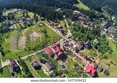 aerial view of village from drone, Romanian Carpathians, Durau mountain resort