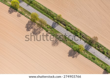 aerial view of village road and harvest fields in Poland - stock photo