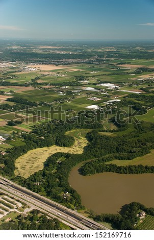 Aerial view of waterway, agriculture and highway - stock photo