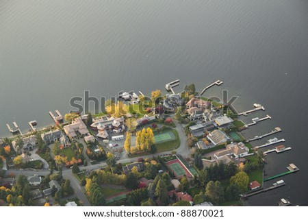 Aerial view of wealthy neighborhood along a lake - stock photo