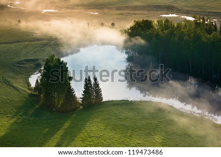Aerial view of yearly misty tranquil morning in Lithuania - stock photo