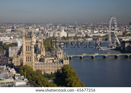 Aerial view on Houses of Parliament, London Eye and Westminster Bridge on Thames River. - stock photo