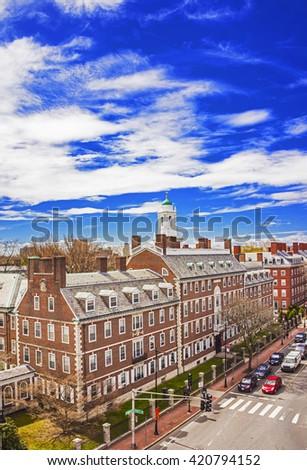 Aerial view on John F Kennedy Street in Harvard University Area in Cambridge, Massachusetts, USA. Eliot House white belltower seen on the background. - stock photo