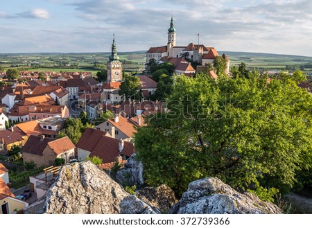 Aerial view on Mikulov town in Czech Republic with Castle and bell tower of Saint Wenceslas Church - stock photo