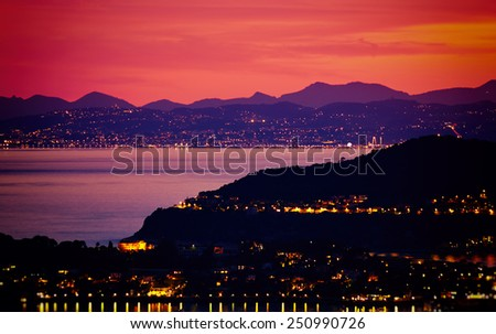 Aerial view on Monaco. Monte Carlo by night. Red sky. - stock photo