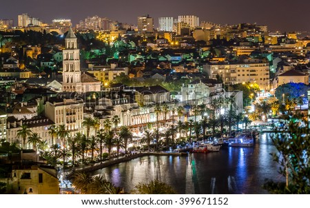 Aerial view on night panorama of old historic town of Split, Croatia. Old architecture and history that attracts many tourists each summer. / Night cityscape town of Split, Croatia. / Long exposure. - stock photo