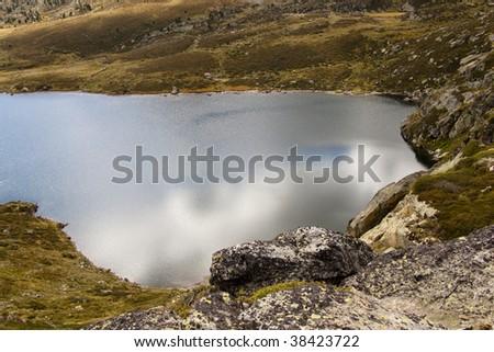 Aerial view on Pedourres lake in Andorra, Pyrenees, Autumn day. - stock photo