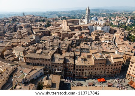Aerial View on Piazza del Campo, Central Square of Siena, Tuscany, Italy - stock photo
