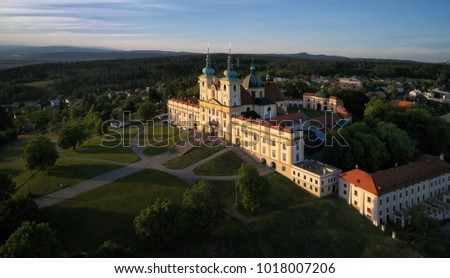 "Aerial view on Pilgrimage Church of the Visitation of the Virgin Mary - pilgrimage site of European significance ""The Holy Hill"" from-afar visible silhouette of basilica minor over moravian landscape."
