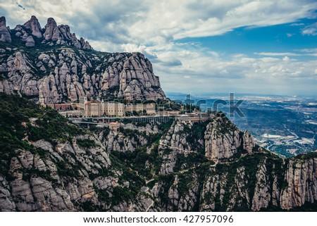 Aerial view on Santa Maria de Montserrat Abbey in Montserrat mountains, Spain - stock photo